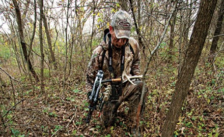 Question:When hunting big woods, what are the best terrain features to look for when trying to find