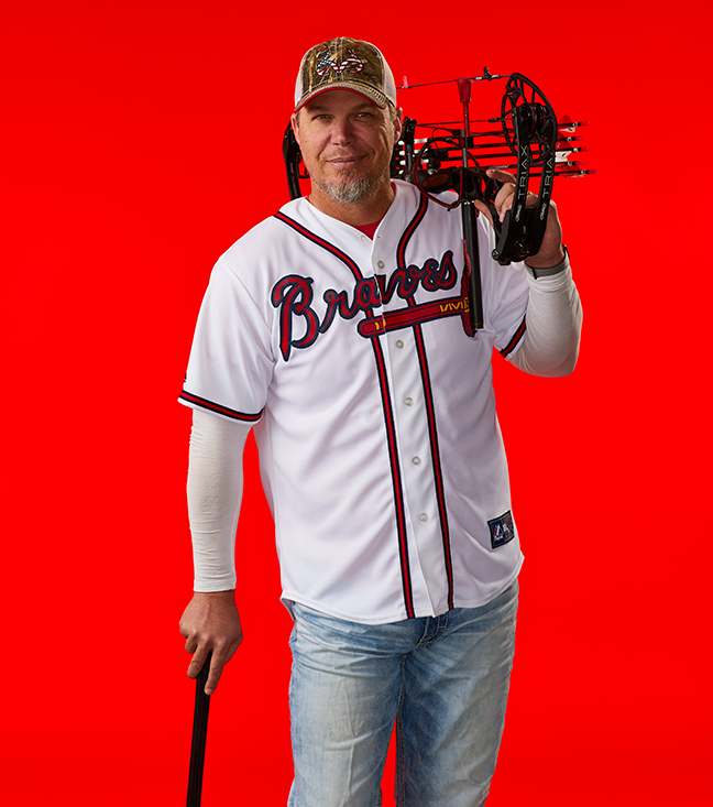 Chipper Jones with bat and bow