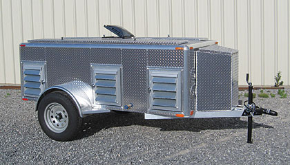 Standard features on all Bitter Creek Dog Trailers include an aluminum frame, one inch of insulation, torsion bar axles, aluminum wheels, LED lighting and a top-wind jack.