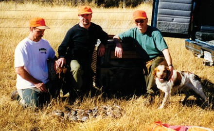 Rick Van Etten (right) with Gus the super-nosed Brittany and cousins Doug and Ryan Clark. Photo by Randy Clark.