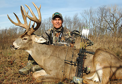 The author displays a heavy-racked Iowa buck he killed well after the primary rut had passed. Photo courtesy of Randy Templeton.