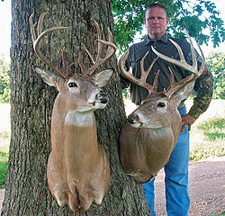 The author shows off two great bucks that he talks about in the story. The buck on the left, grossing just shy of 170 points, was taken downwind as the author worked a doe bedding area. The buck actually scented the author but could not see him. The buck on the right was taken at a distance of 12 feet. The buck walked up on the author as he was sitting on the ground resting.
