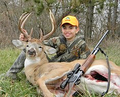 While hunting near Clinton, Illinois, 10-year-old Ty Berter was able to take his first buck this