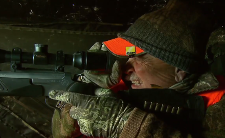 Sitting in a ground blind over a cut wheat field, Stan Potts hunts Montana whitetails with his