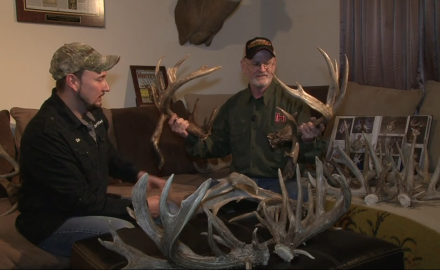 Gordon Whittington talks with an avid shed antler collector about his arsenal of big non-typical
