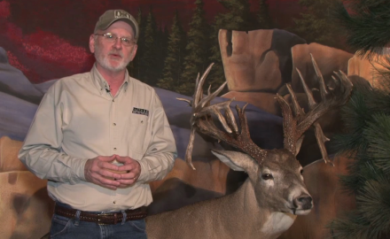 Gordon Whittington highlights a state-record holding buck that was taken back in 1997 in West