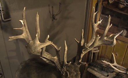 A pair of Ohio hunters talk with Pat Hogan about a big buck that had been wounded and later turned