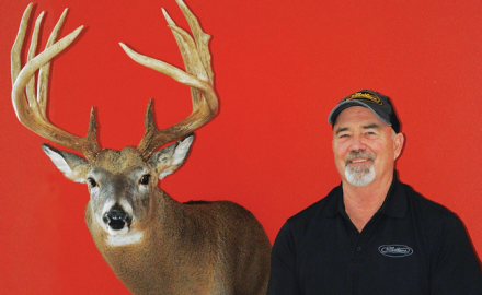 John Kassera held his bow at full draw trying to steady the 20-yard sight pin on the shoulder of