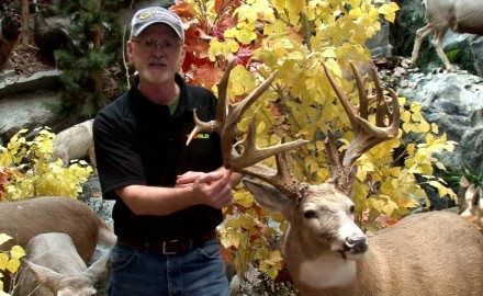 Gordon Whittington shows off a trophy buck taken by Jerry Roitsch in South Dakota in this edition