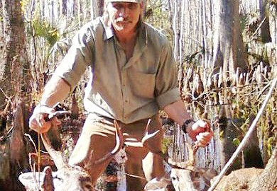 In this photo posted on Facebook, Darin Lee Waldo poses with two illegally taken whitetail deer.