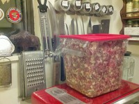 Rinella is processing this bin of bear meat into summer sausage.