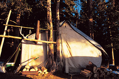 The advantage of a canvas wall tent over a lightweight model is the addition of a stove for cooking and heating. Keeping a good stock of wood nearby is certainly a necessity though.