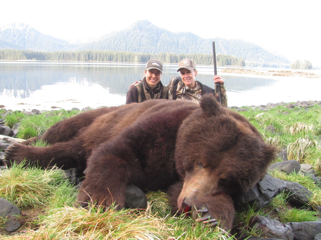 Outfitter Alisha Rosenbruch-Decker (left) and Donna Boddington (right) with an exceptional Alaskan brown bear.