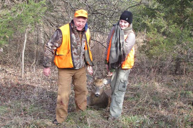 female-hunter-brittany-dragging-deer
