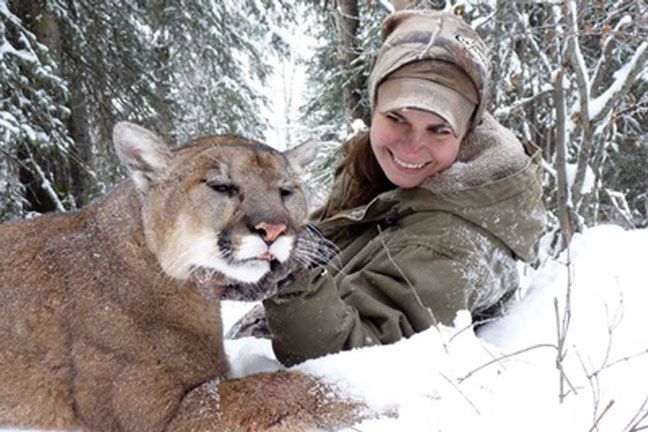 female-hunter-with-mountain-lion