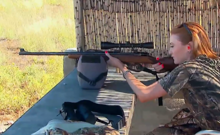 Brittany Boddington is testing her CZ Rifle before heading off on a hippo hunt.