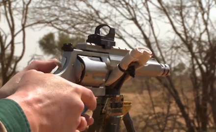 Smith & Wesson's Tony Miele and host Kevin Steele track an African lion across the Kalahari for the