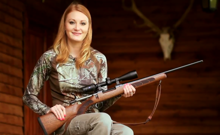 Brittany Boddington sights in her CZ Rifle and Zeiss scope as she prepares to hunt red stag and
