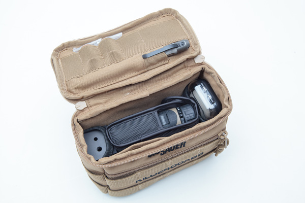 The kit includes a MOLLE case, the rangefinder unit, a lanyard, a nylon carrying case, the WeatherFlow meter, tripod adapter, and a Sig Sauer tactical pen.