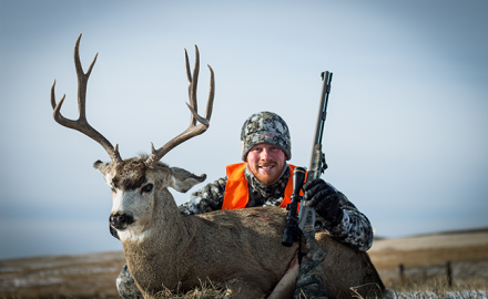 Darron McDougal with mule deer
