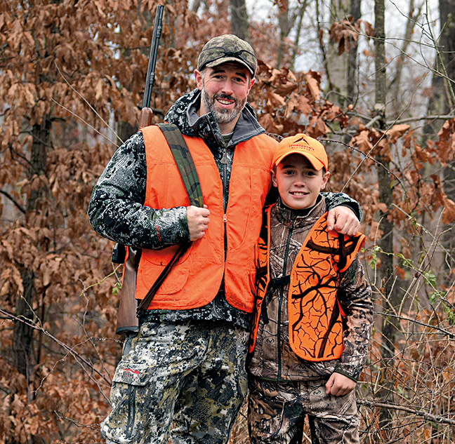 Adult mentoring youth hunter