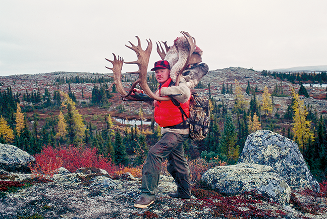 Craig Boddington carrying out caribou antlers