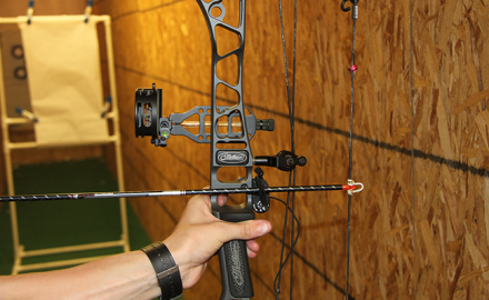 Bowhunter adjusting sight