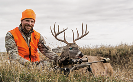 Joseph Von Benedikt with whitetail buck