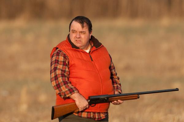 Poacher holding a shotgun