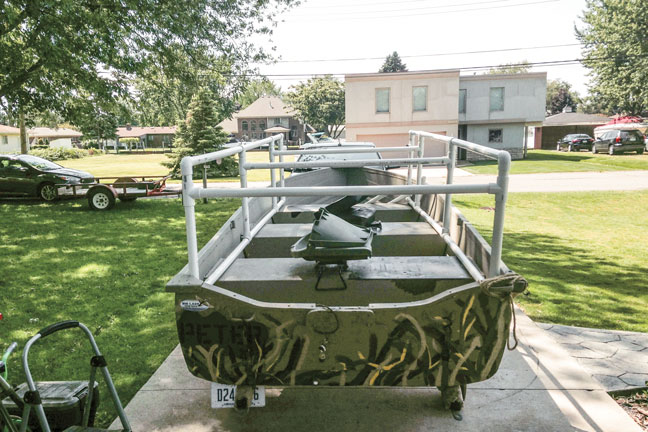 Assembling a boat blind for duck hunting