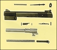 By David W. Arnold    Slide/Barrel assembly showing cam under barrel and sear