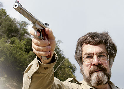 The author draws a bead with Ruger's new Mark III. Note the crowned muzzle and HiViz front sight.