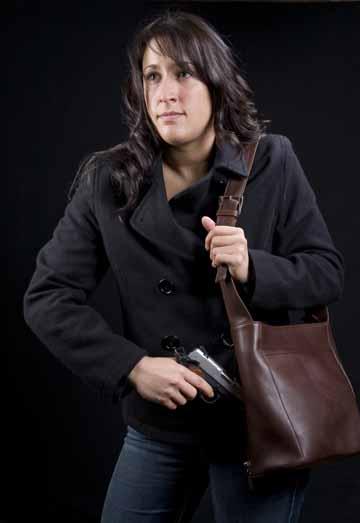 woman drawing concealed handgun