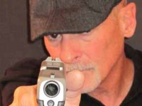 Dave Spaulding pointing gun