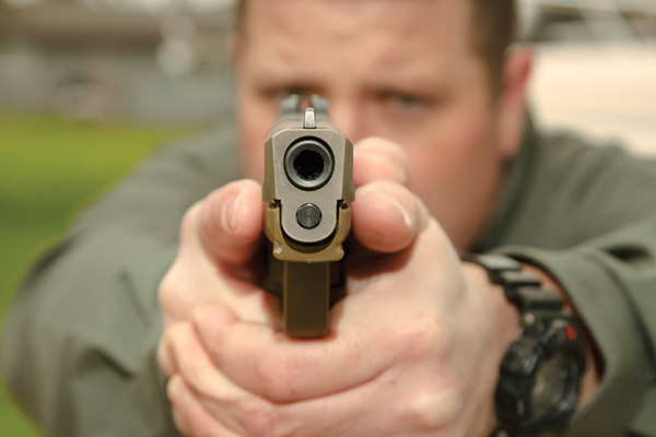When faced with a potential deadly threat, your handgun belongs in your hand, not in your holster