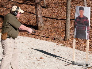 When challenging, point the gun at the ground just in front of the target, and use a loud, command voice.