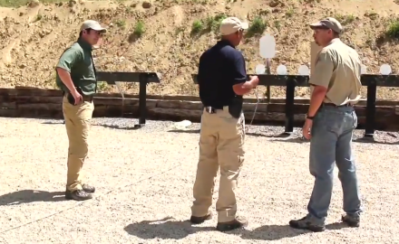 Former SEAL Jim Kauber runs our hosts through a deliberately distracting set of pistol drills to