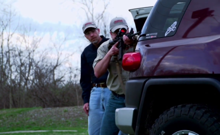 Rich Nance does his best to shoot Jim Tarr's car while demonstrating fighting from a vehicle.