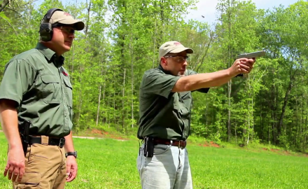 James Tarr shows Richard Nance a number of common sense tricks he's learned shooting competitively