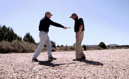 Richard Nance and James Tarr work through edged weapons defense tactics.