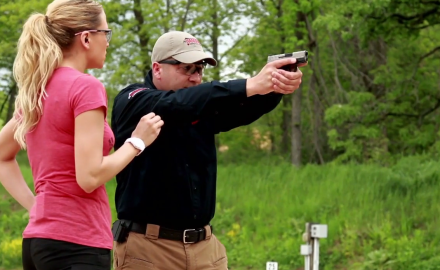Jessica Nyberg helps Richard Nance with some techniques to improve handgun accuracy.