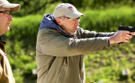 James Tarr and Richard Nance discuss tactics for improving accuracy with a pistol.