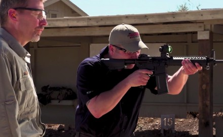 Richard Nance and James Tarr function test an AR-15 rifle after they have taken it apart for