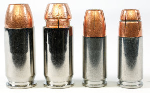As both a visual and tactile indicator, the .45 FBI load (second from l.) and subsonic 9mm load (r.) are marked with a groove.