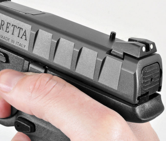 The aggressive slide serrations separate the Beretta from the pack, and the gun features sturdy steel sights—which is good because the protruding firing pin block will make red dot mounting difficult.