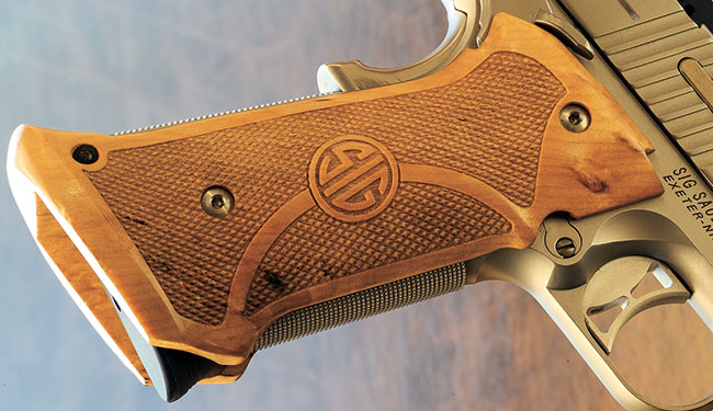 The custom wood grips are exquisitely checkered, incorporate the SIG logo and extend beyond the frame to create a defacto mag well funnel.