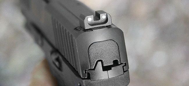The sturdy, steel rear sight can be used for racking the pistol. It features two luminescent dots that pair up with a single dot on the front post.