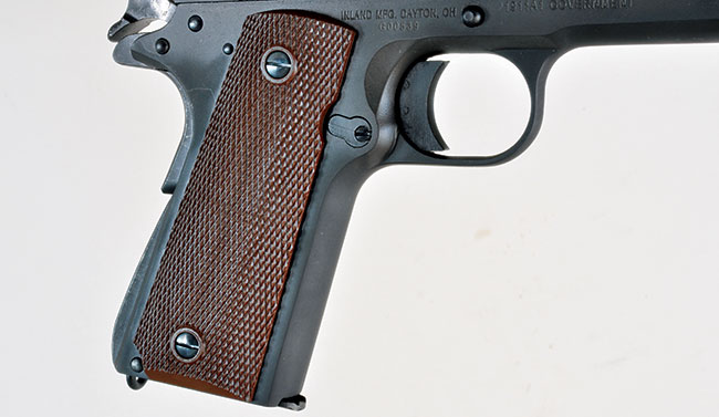 The 1911A1 features the original's brown plastic grips, a short trigger and an arched mainspring housing. However, the Inland gun does employ a Series 80 firing pin safety.