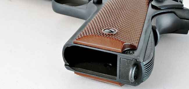 Unlike original 1911A1s, the magazine well on the Inland gun is treated to a slight bevel. It does, however, retain the lanyard loop.