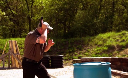 Richard Nance demonstrates how to position the muzzle of your handgun.